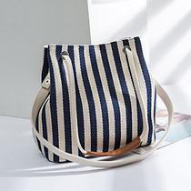 新款女包帆布水桶包条纹单肩包高级感百搭潮法国小众洋气夏季女包